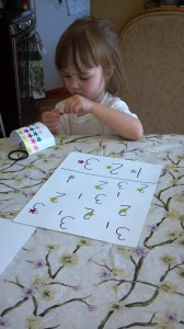 Chloe working on one of her homemade worksheets.